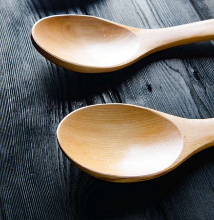 Wooden spoons arranged on table Фото со стока
