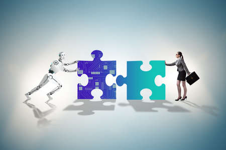 Robot and human cooperating in jigsaw puzzle 免版税图像