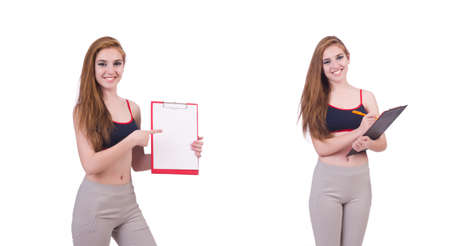 Young woman with notepad writing on white Stockfoto