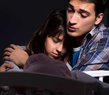 Young parents sleepless with newborn baby at night