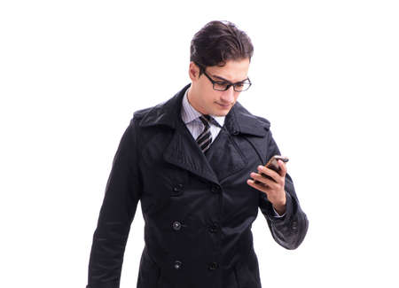 Young businessman wearing winter coat isolated on white 스톡 콘텐츠