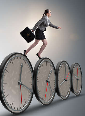 Businesswoman in time management concept Banque d'images
