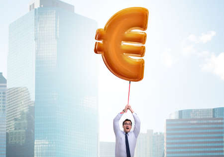 Businessman flying on euro sign inflatable balloon