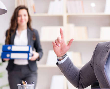 Angry boss unhappy with female employee performance Stock Photo - 127337104