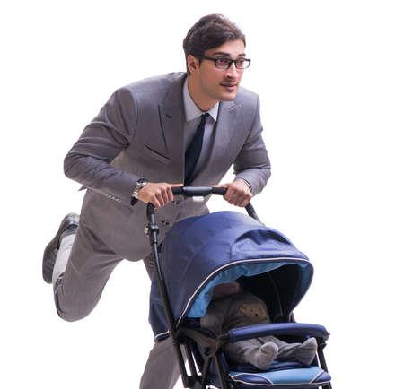 Young businessman nursing child in pram isolated on white Reklamní fotografie