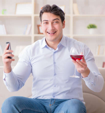 Young man chatting with his sweetheart over mobile phone Standard-Bild