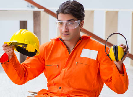 Worker showing the importnace of wearing noise cancelling headph Stock Photo