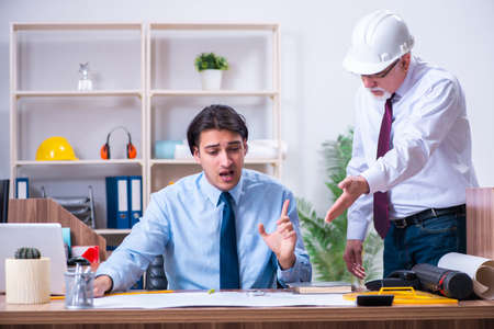 Two architects working on the project Stock Photo