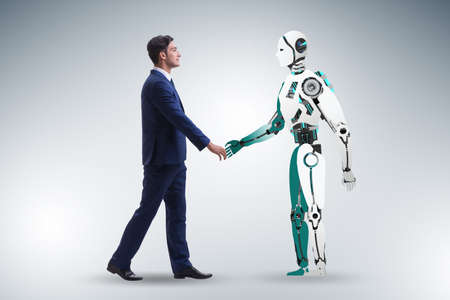 Concept of cooperation between humans and robots 스톡 콘텐츠