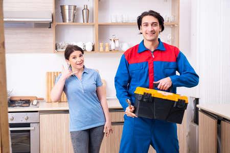 Young male repairman repairing tap Reklamní fotografie