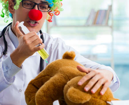 Funny pediatrician with toy in the hospital clinic