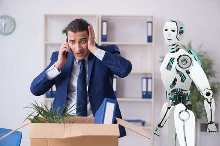 Concept of robots replacing humans in offices Stock Photo