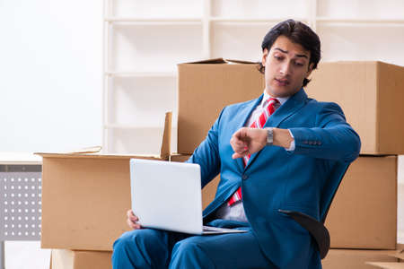 Young handsome businessman moving to new workplace