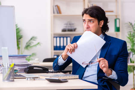 Young businessman sitting and working in the office Stock Photo