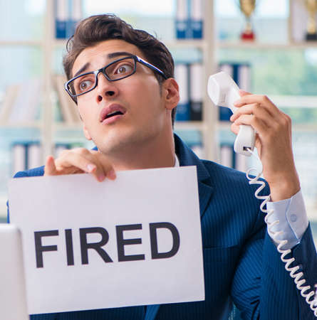 Businessman with message in the office at desk Stock Photo