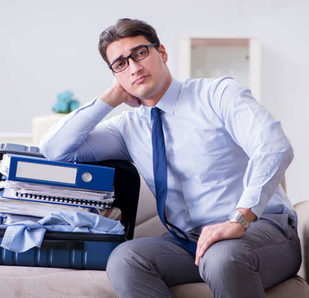 Businessman preparing packing for business trip Stock Photo