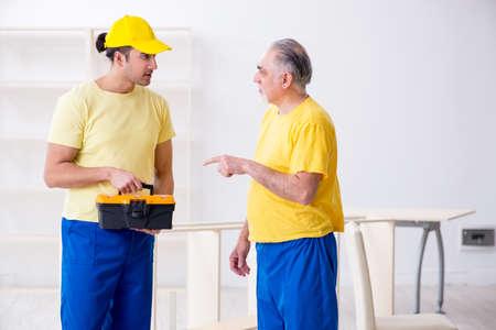 Two contractors carpenters working indoors