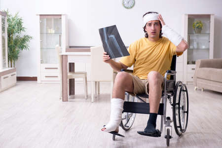 Young man after accident recovering at home