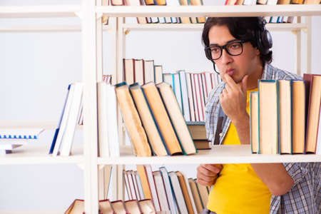 Male student preparing for exams at library