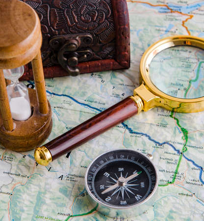 Travel concept with compass and map Banco de Imagens