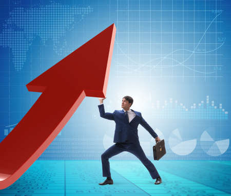 Businessman supporting growtn in economy on chart graph Stockfoto - 128449302