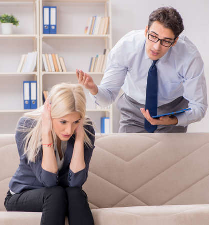 Young woman visiting psychiatrist man doctor for consultation Imagens