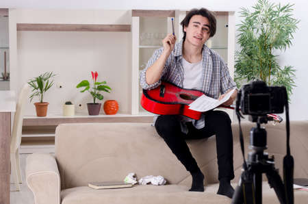 Young guitar player recording video for his blog Stockfoto
