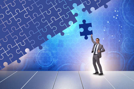 Concept of businessman with missing jigsaw puzzle piece Banco de Imagens - 128451404