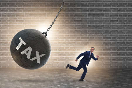 Businessman running away from high taxes Stock Photo