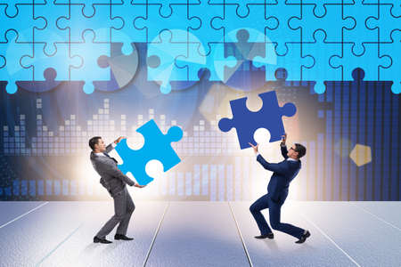 Concept of businessman with missing jigsaw puzzle piece Banco de Imagens - 128450346