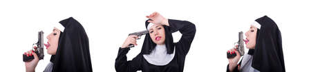 Nun with gun isolated on the white 스톡 콘텐츠
