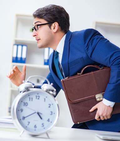 Businessman in bad time management concept Stockfoto - 128707313