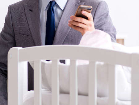 The young businessman trying to work from home caring after newborn Zdjęcie Seryjne