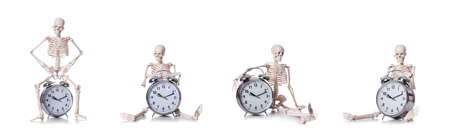 The skeleton with alarm clock on the white Stockfoto - 129022418