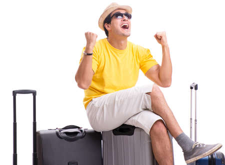 Happy young man going on summer vacation isolated on white Фото со стока