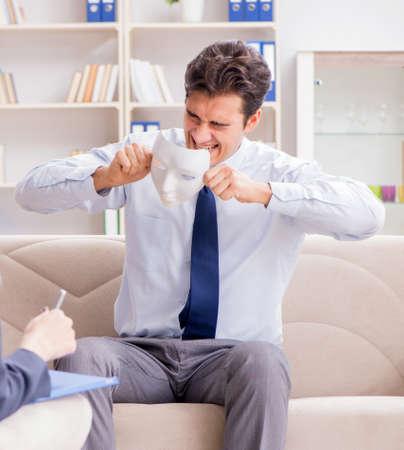 Young man visiting psychiatrist doctor for consultation Reklamní fotografie