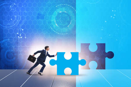 Concept of businessman with missing jigsaw puzzle piece 版權商用圖片