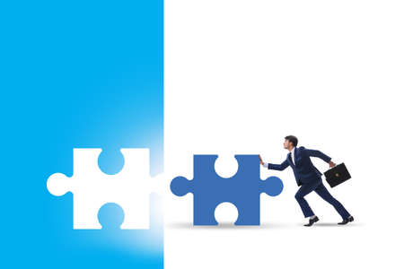 Concept of businessman with missing jigsaw puzzle piece Reklamní fotografie
