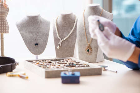 Young jeweler working in his workshop