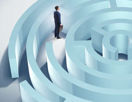 Businessman is trying to escape from maze labyrinth Stockfoto