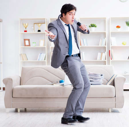 Drunk businessman celebrating in the office