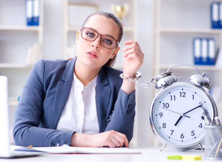 Businesswoman in time management concept Stockfoto - 129098738