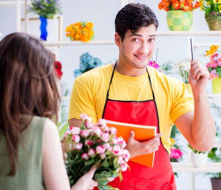 Florist selling flowers in a flower shop Reklamní fotografie