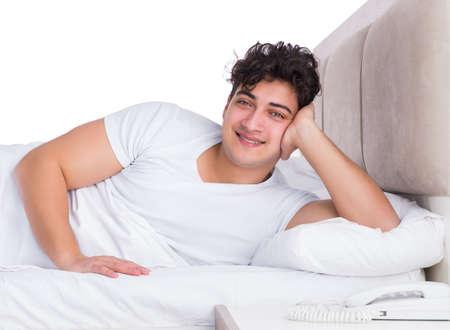 Man in bed suffering from insomnia Reklamní fotografie