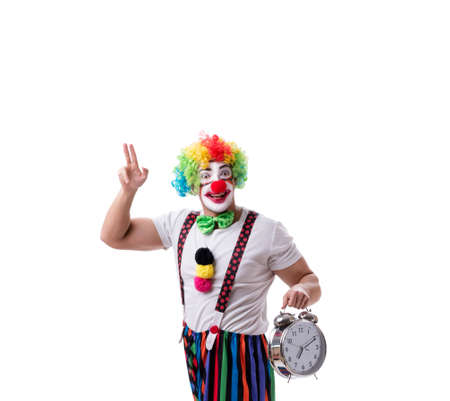 Funny clown with an alarm clock isolated on white background Stockfoto - 129099769