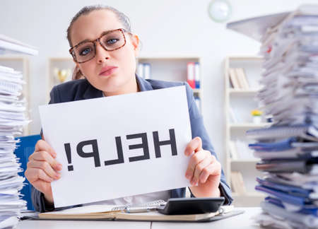 Businesswoman pleading for help in office Stock Photo
