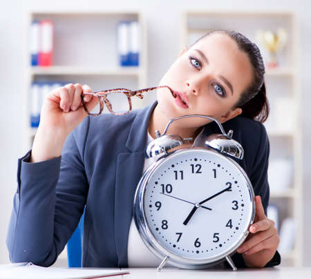 Businesswoman in time management concept Stockfoto