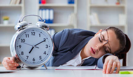 Businesswoman in time management concept sleeping