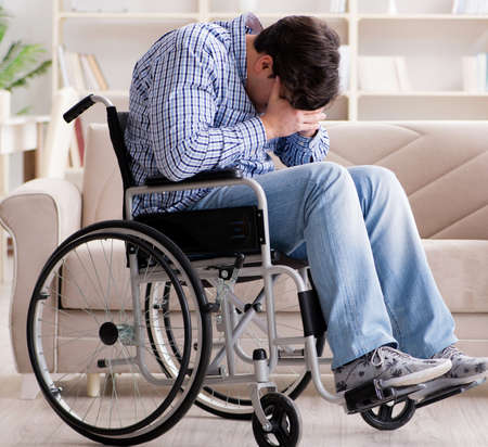 Desperate disabled person on wheelchair Stock Photo
