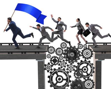 Business people crossing the bridge with cogwheels 스톡 콘텐츠 - 129287567